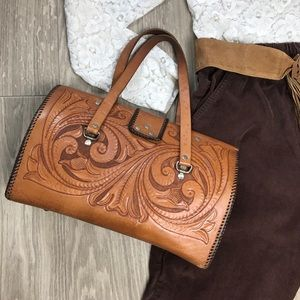 Handtooled leather purse 1970s
